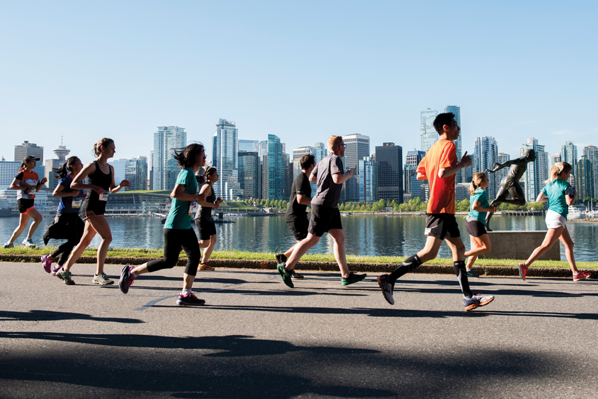 City landmarks. Runners race past iconic Vancouver landmarks, pictured here against the city's skyline and legendary Harry Jerome Statute. Photo: Ivan Calderon / RUNVAN®
