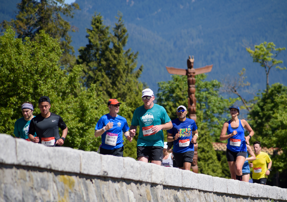 Look everywhere! The mountains beckon, the ocean glistens, and iconic landmarks line the courses of the BMO Vancouver Marathon. Photo: Ayumu / RUNVAN®