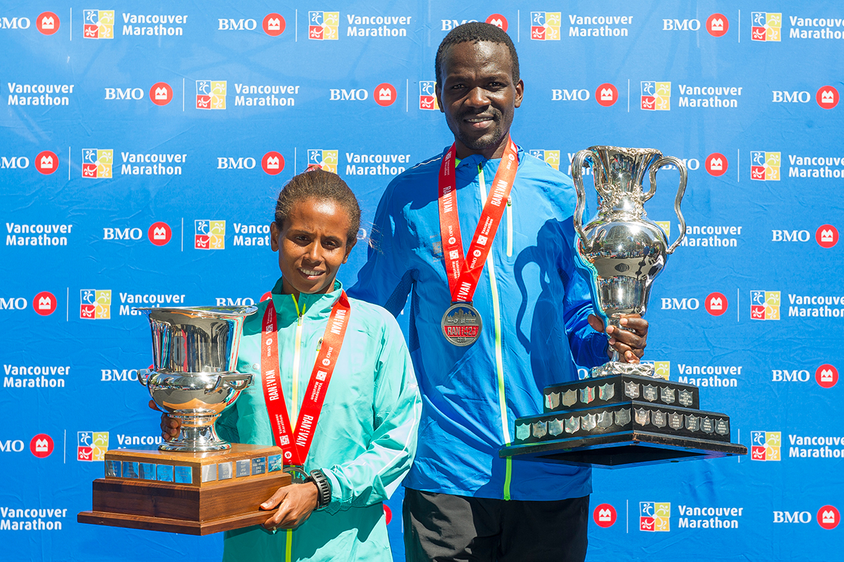 Sweet comebacks. Kenya's Daniel Kipkoech and Ethiopia's Hirut Guangul came back to win Marathon titles after each finished second last year. Event records of 2:13:14 and 2:35:50 remained unthreatened: http://bmovanmarathon.ca/event-records Photo: Richard Lam / RUNVAN®