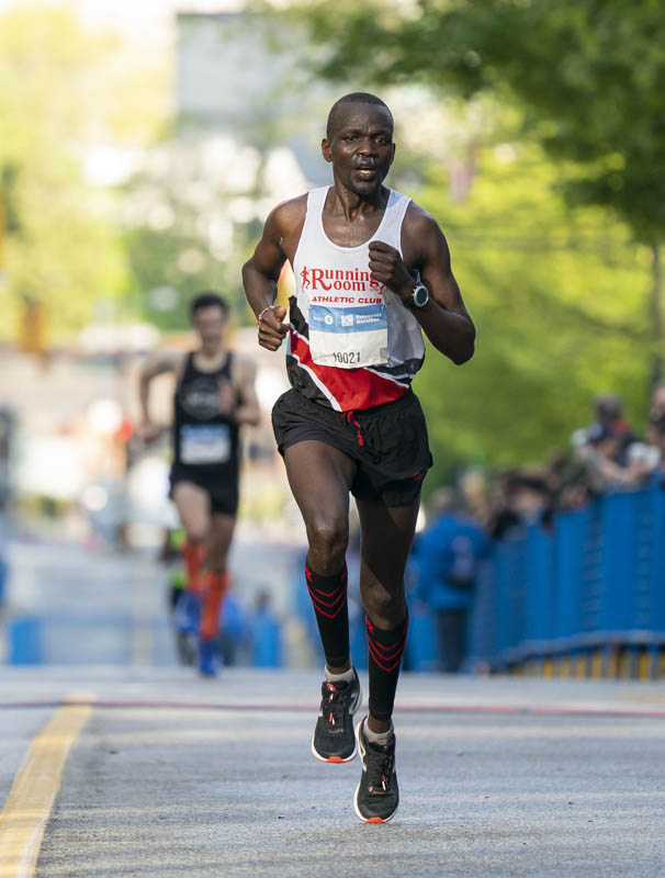 Daniel Kipkoech, the two-time defending Marathon champion, settles for second in this year's Half Marathon. Photo: Richard Lam / RUNVAN®
